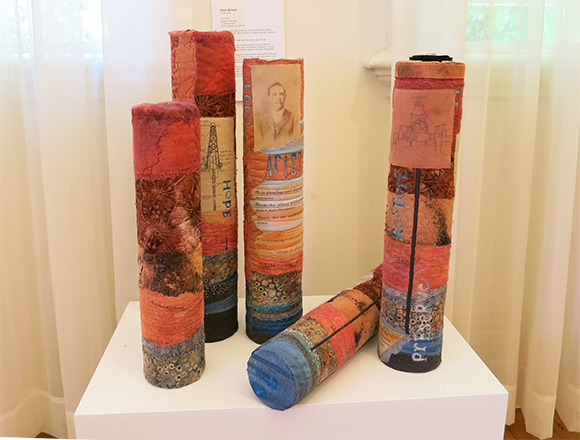 Fortune, Sculpture: Drill cores, cylindrical pieces, 8-10cm diameter, max 52cm (h). Hand-dyed & commercial fabrics, machine stitching & quilting, hand embroidery.
